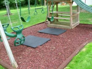 rubber mulch mats under a swingset